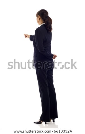 Mature Asian business woman pointing at something over white