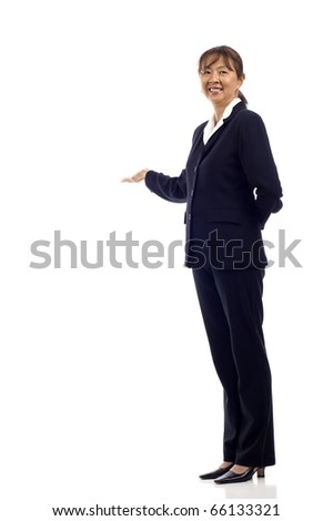 Mature Asian business woman presenting something isolated over white background, a lot of copyspace