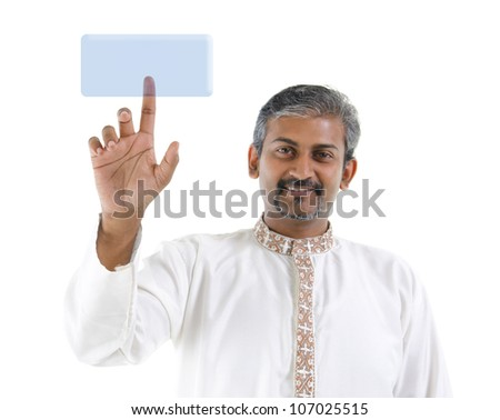 Mature Asian Indian business man pointing on virtual screen button