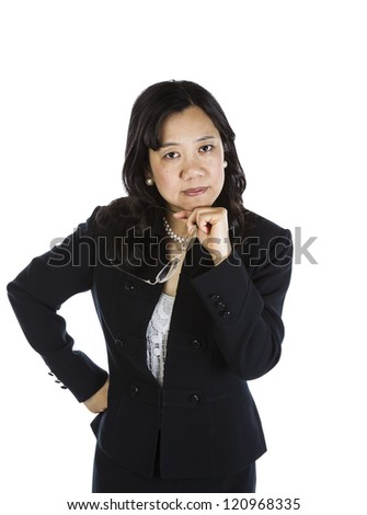 Mature Asian Woman resting chin in hand and holding glasses on white background