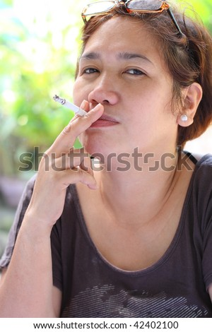 stock photo mature asian woman smoking a cigarette 42402100 WoW   Night Elf by GoldfishValhalla. 17985.jpg