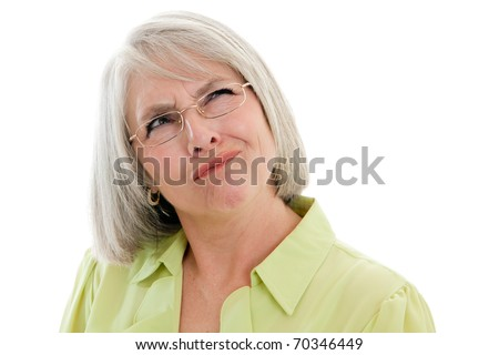 Mature, attractive Caucasian woman making a confused face - stock photo