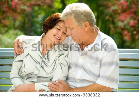 Mature attractive happy couple together in park