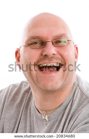 stock photo : Mature bald man with a very fake laugh. Save to a lightbox ▼