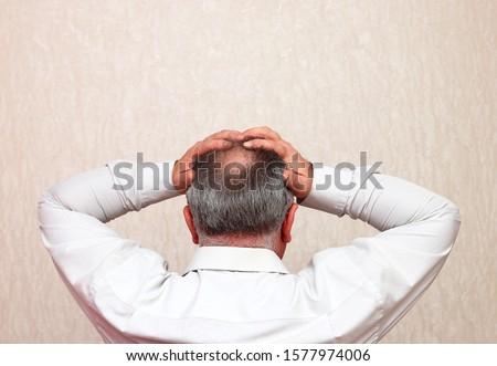 Mature balding, befuddled office worker