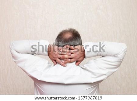 Mature balding tired office worker