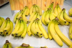 mature bananas display on the market