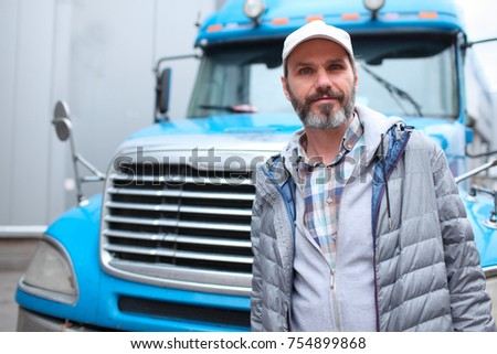 Mature bearded man against retro styled truck