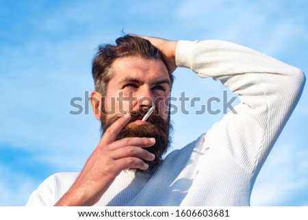 Mature blonde bearded guy with trendy hairdo in casual shirt. Professional model and professional photo shoot