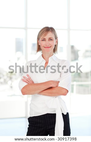 stock photo : Mature blonde businesswoman with folded arms