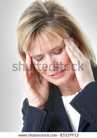 Mature business lady having headache. Over grey background.