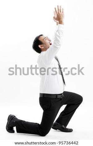 Mature business man begging, full length portrait isolated on white. - stock photo