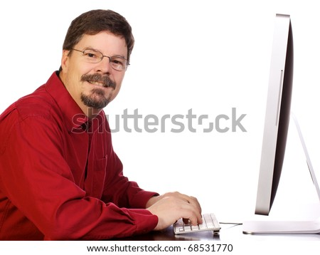 Mature business man content while he is working on his computer.