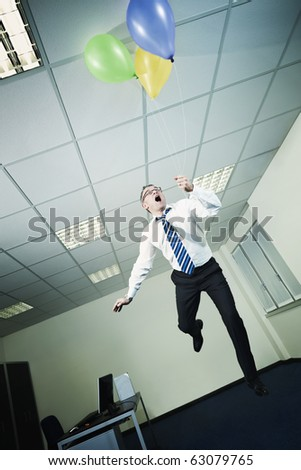 mature business man holding colored balloons and flying in office. Vertical shape, full length, Copy space