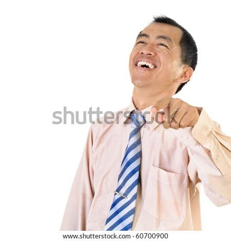Mature business man laughing and pointing with copyspace on white.