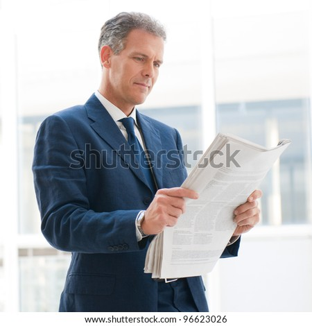 Mature business man reading news in the office