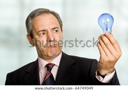 mature business man with a lamp at the office