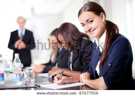 Mature businessman conducting training professionals taking notes