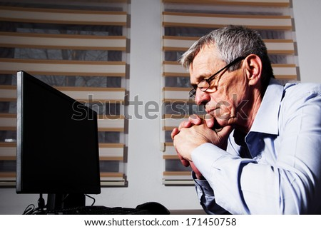 Mature Businessman has a problem at his work