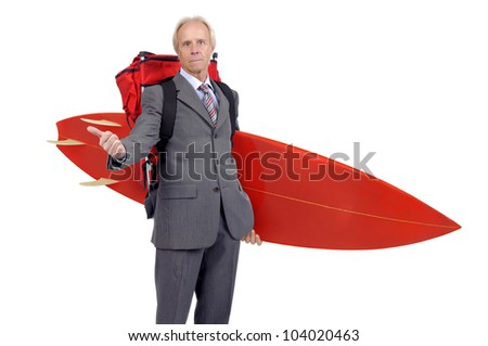 Mature businessman hitchhiking with backpack and surf board