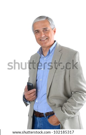Mature businessman in casual attire holding a cell phone.