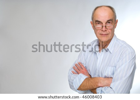 mature businessman in glasses
