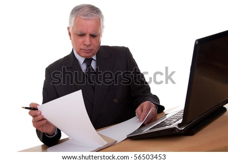 mature businessman  looking to computer, isolated on white background. Studio shot.