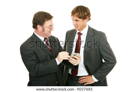 Mature businessman mentoring a young colleague.  Isolated on white.