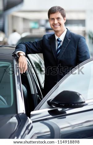 Mature businessman near a car