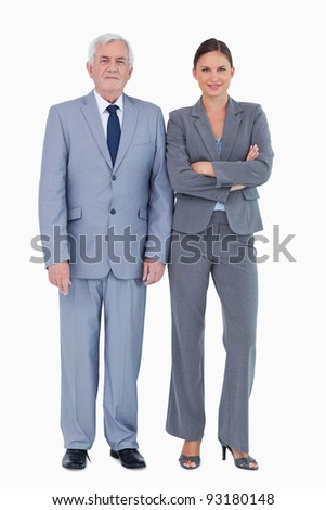 Mature businessman next to colleague against a white background