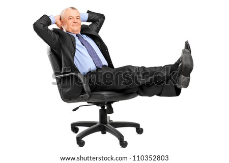 Mature businessman resting in armchair with legs up isolated on white background