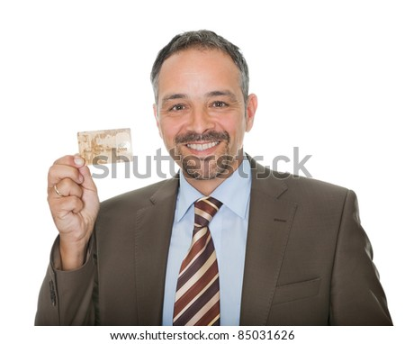 Mature businessman showing a credit card