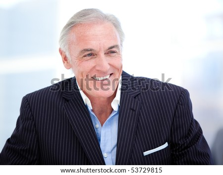 Mature businessman smiling at the camera. Business concept.
