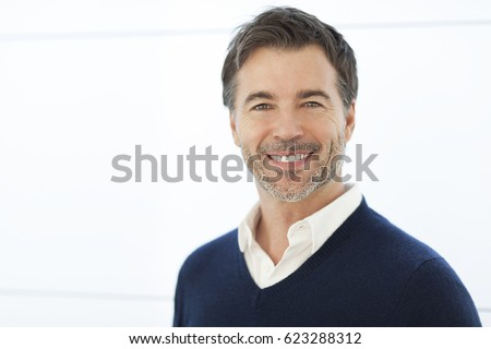 Mature Businessman Smiling At The Camera. Isolated On White.