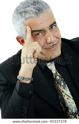 Mature businessman thinking leaning on hand, looking at camera, smiling. Isolated on white.
