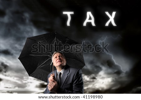 mature businessman under a storm of taxes
