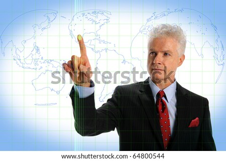 Mature businessman using touch screen interface with world map - stock photo