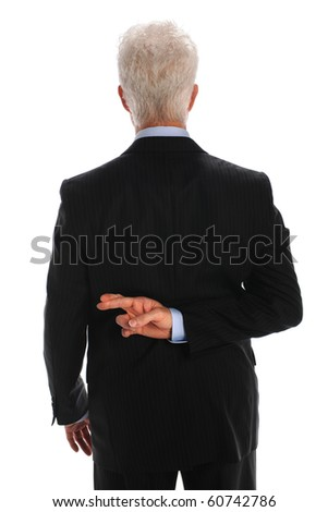 Mature businessman with fingers crossed behind back isolated over white background