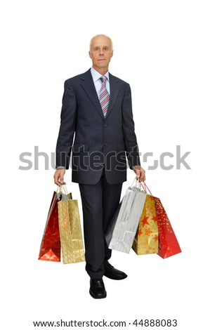 Mature businessman with lots of bags shopping isolated in white