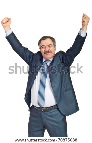 Mature businessman with success in business raising arms and smiling isolated on white background