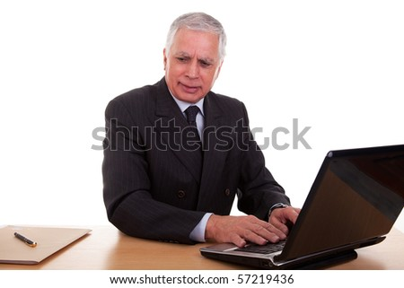 mature businessman  working at computer, isolated on white background. Studio shot.