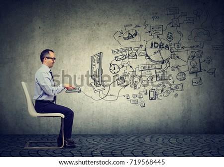 Mature businessman working in an office #719568445