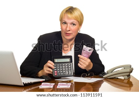 Mature businesswoman showing the sum of money on the calculator. Isolated against white background.