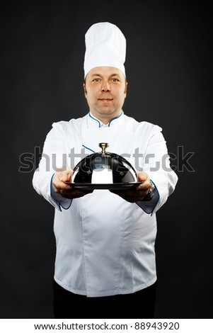 mature caucasian male chef over grey background