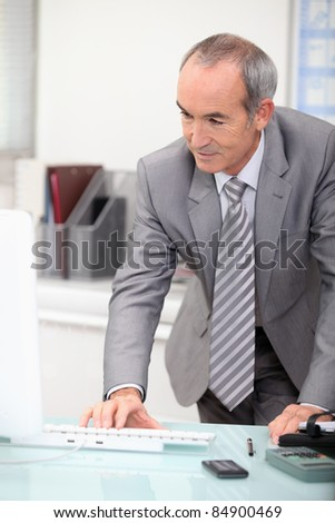 mature ceo working at office - stock photo