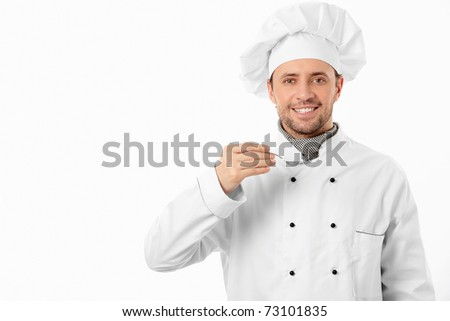 Mature cook with spoon on white background - stock photo
