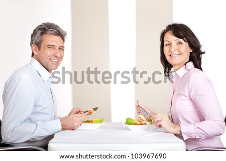 Mature couple having lunch together at home