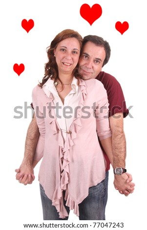 Mature couple love with red hearts flying - stock photo