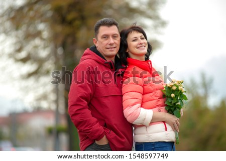 Mature couple. Mature couple with a bouquet of flowers.