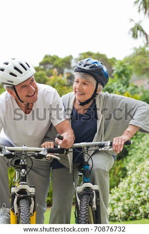 Mature couple mountain biking outside